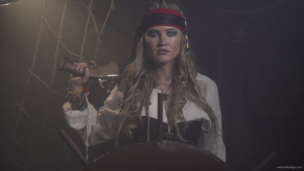 Captain-pirate-woman-stands-near-the-ship-helm-and-floats-against-wind_002 🔴  National Footage
