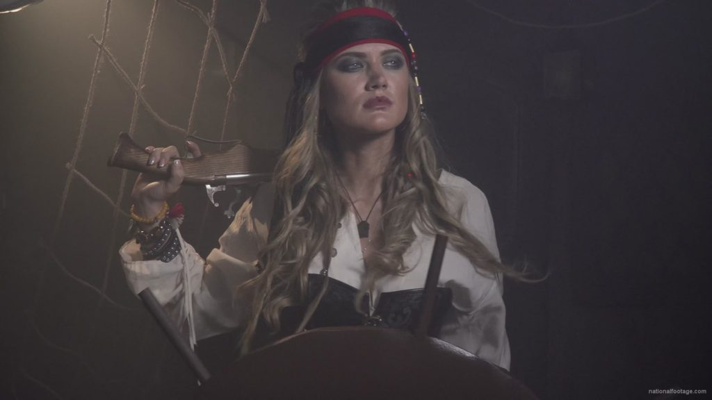 Captain-pirate-woman-stands-near-the-ship-helm-and-floats-against-wind_008 🔴  National Footage