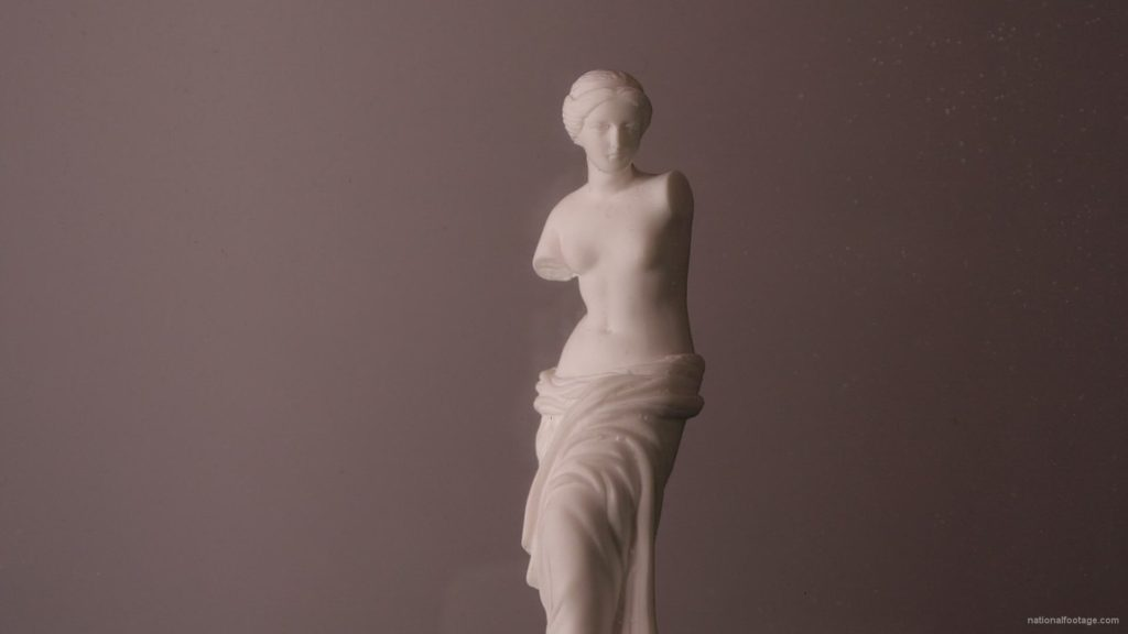 Beauty-Venus-statue-with-gold-dollars-coins-falls-in-slow-motion_001 National Footage