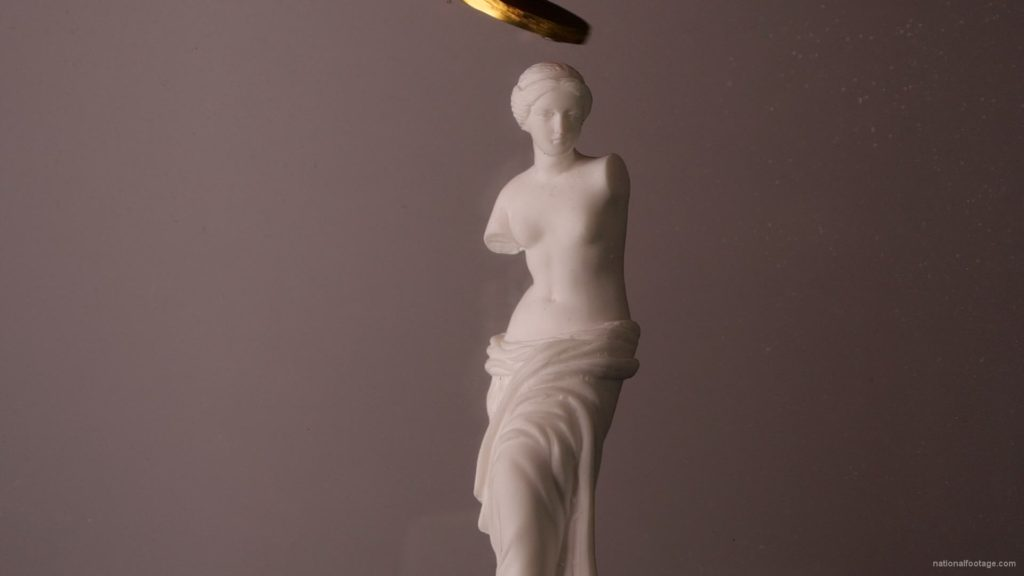 Beauty-Venus-statue-with-gold-dollars-coins-falls-in-slow-motion_002 National Footage
