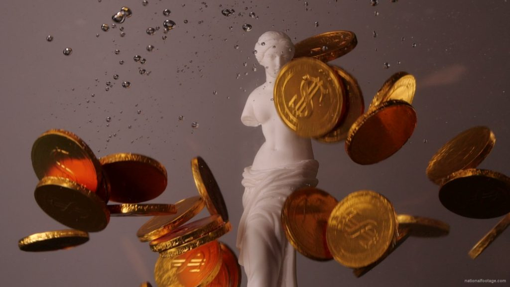 Beauty-Venus-statue-with-gold-dollars-coins-falls-in-slow-motion_004 National Footage