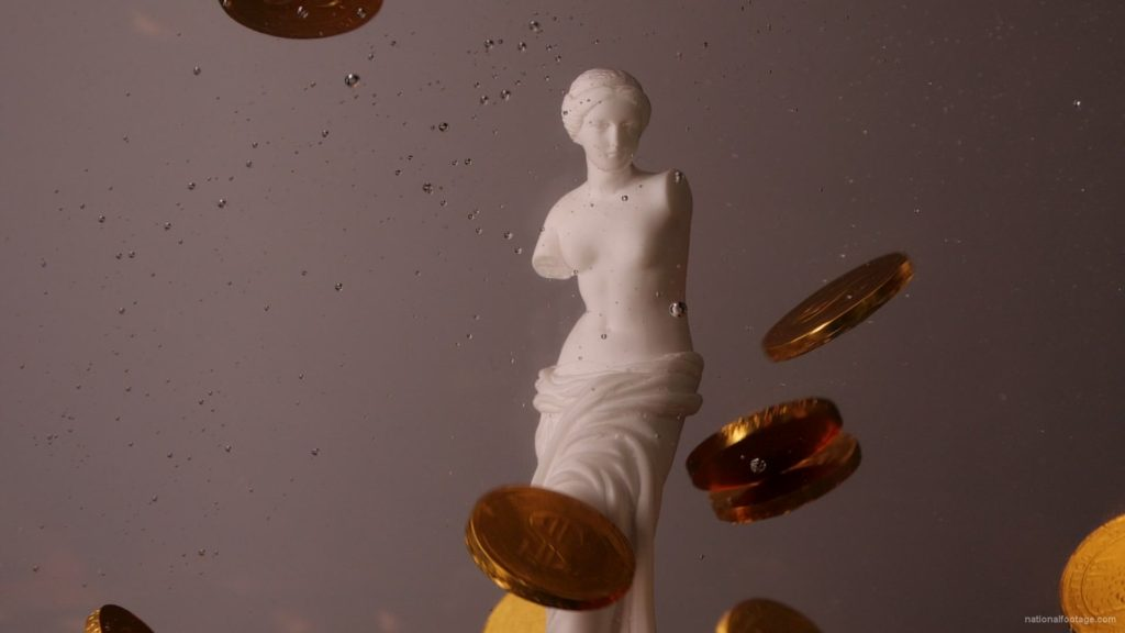 Beauty-Venus-statue-with-gold-dollars-coins-falls-in-slow-motion_005 National Footage