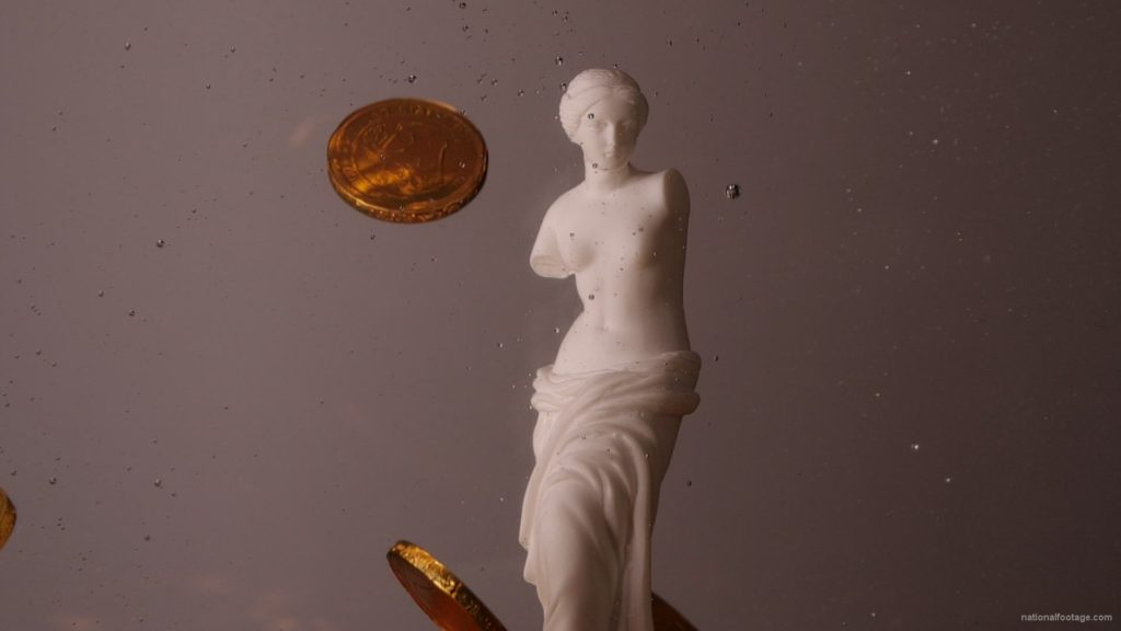 Beauty-Venus-statue-with-gold-dollars-coins-falls-in-slow-motion_006 National Footage