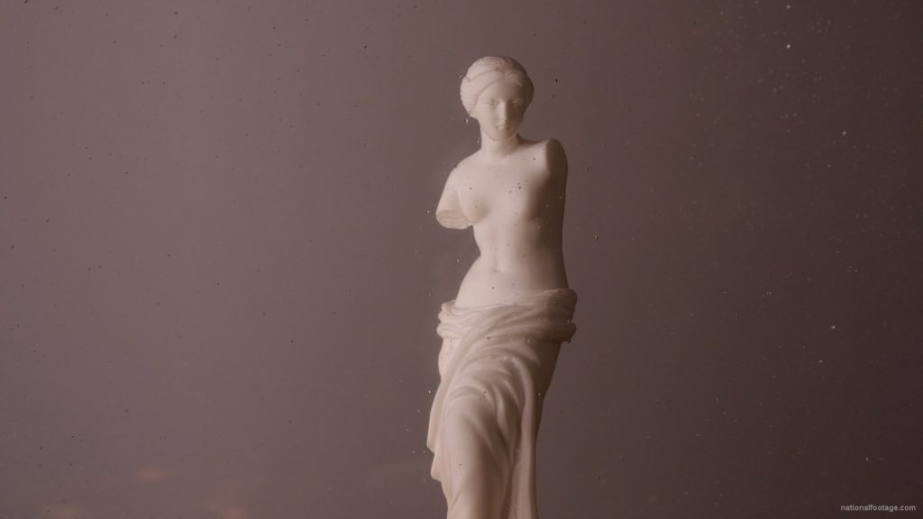 Beauty-Venus-statue-with-gold-dollars-coins-falls-in-slow-motion_008 National Footage