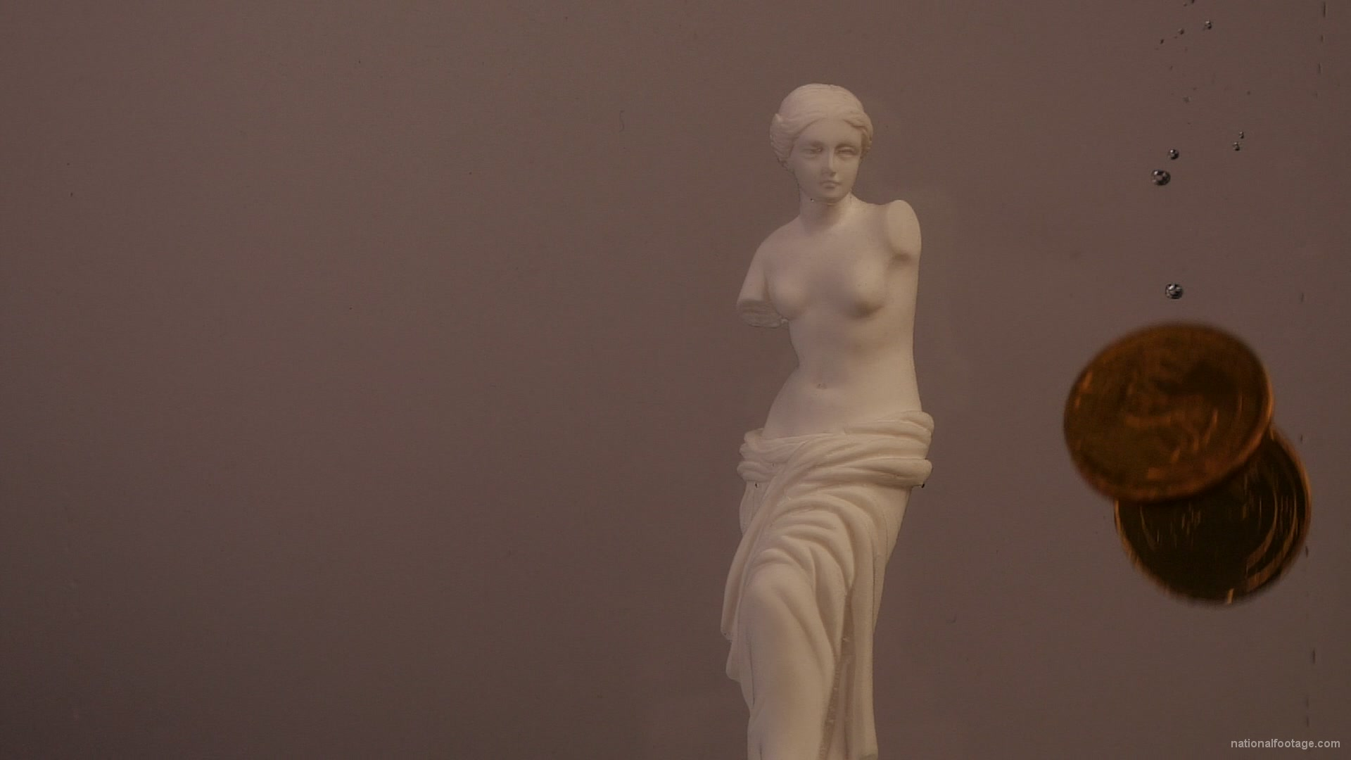 vj video background Venus-Aphrodite-statue-in-watter-with-golden-coins-slow-motion_003