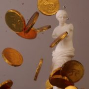 Venus-Aphrodite-statue-in-watter-with-golden-coins-slow-motion_005 National Footage