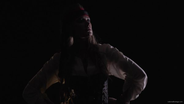 pirate-woman-looking-into-the-telescope-gets-a-pistol-and-runs-into-an-attack_001 National Footage
