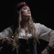 pirate-woman-looking-into-the-telescope-gets-a-pistol-and-runs-into-an-attack_002 National Footage
