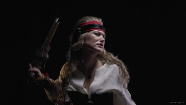 pirate-woman-looking-into-the-telescope-gets-a-pistol-and-runs-into-an-attack_007 National Footage