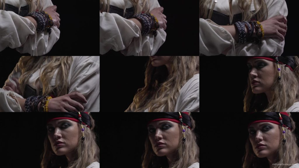 pirate-woman-with-bracelets-on-her-hands-and-a-red-bandage-on-her-head National Footage