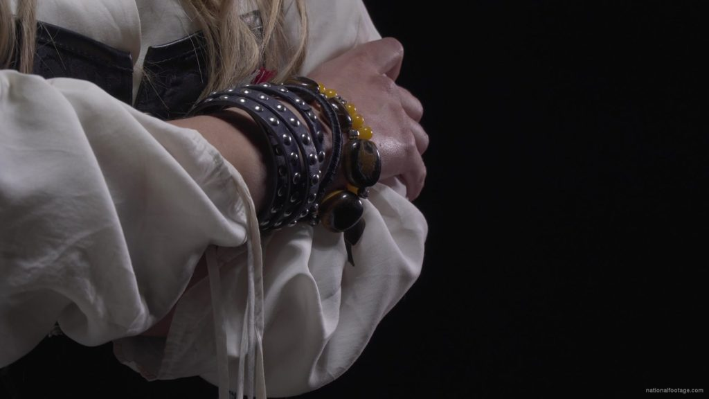 pirate-woman-with-bracelets-on-her-hands-and-a-red-bandage-on-her-head_001 National Footage