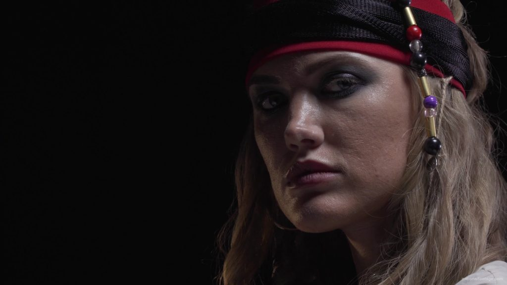 pirate-woman-with-bracelets-on-her-hands-and-a-red-bandage-on-her-head_009 National Footage