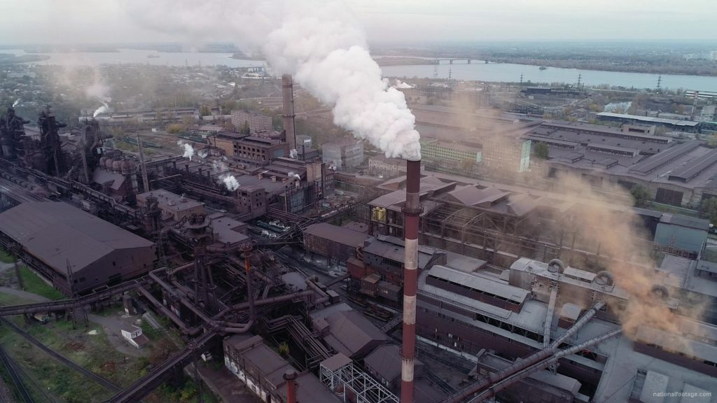 Air-polution-large-pipe-with-a-thick-coal-smelter_001 National Footage