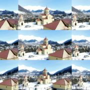 Beautiful-church-on-the-background-of-the-great-snow-capped-mountains-from-the-height-of-the-birds-eye National Footage