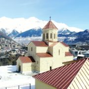 Beautiful-church-on-the-background-of-the-great-snow-capped-mountains-from-the-height-of-the-birds-eye_001 National Footage