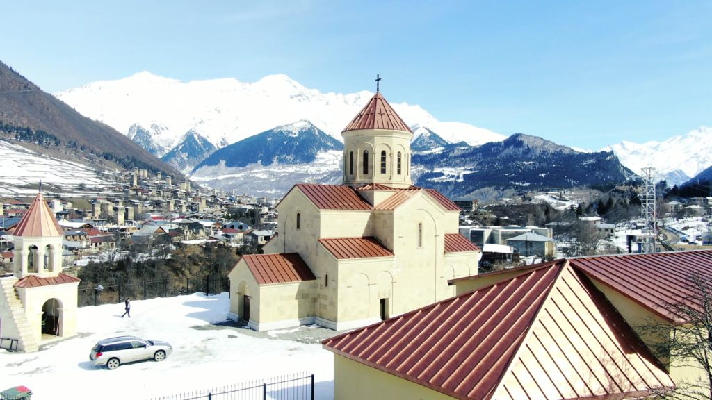 Beautiful-church-on-the-background-of-the-great-snow-capped-mountains-from-the-height-of-the-birds-eye_002 National Footage