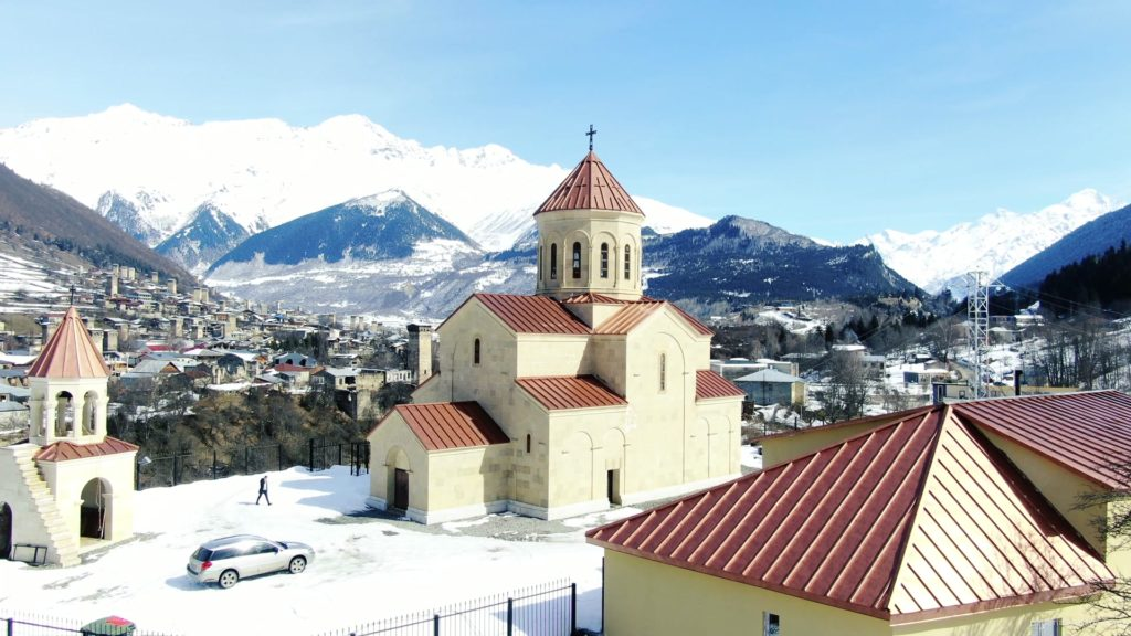 Beautiful-church-on-the-background-of-the-great-snow-capped-mountains-from-the-height-of-the-birds-eye_004 National Footage