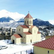 Beautiful-church-on-the-background-of-the-great-snow-capped-mountains-from-the-height-of-the-birds-eye_005 National Footage