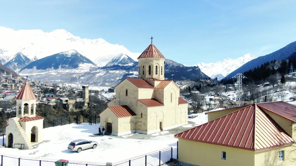 Beautiful-church-on-the-background-of-the-great-snow-capped-mountains-from-the-height-of-the-birds-eye_006 National Footage