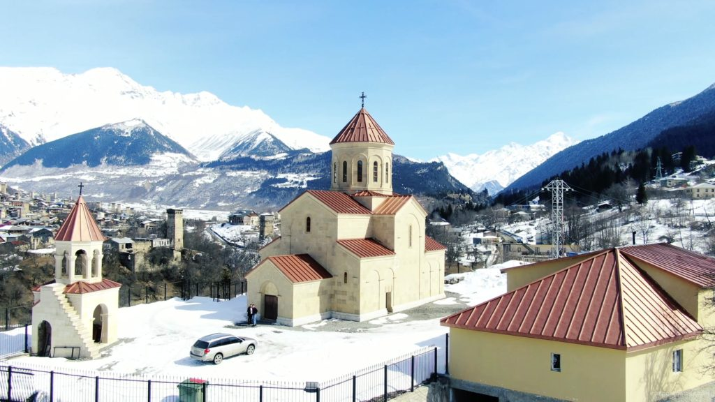 Beautiful-church-on-the-background-of-the-great-snow-capped-mountains-from-the-height-of-the-birds-eye_007 National Footage