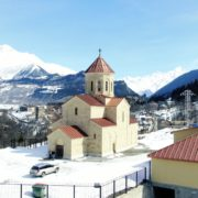 Beautiful-church-on-the-background-of-the-great-snow-capped-mountains-from-the-height-of-the-birds-eye_008 National Footage