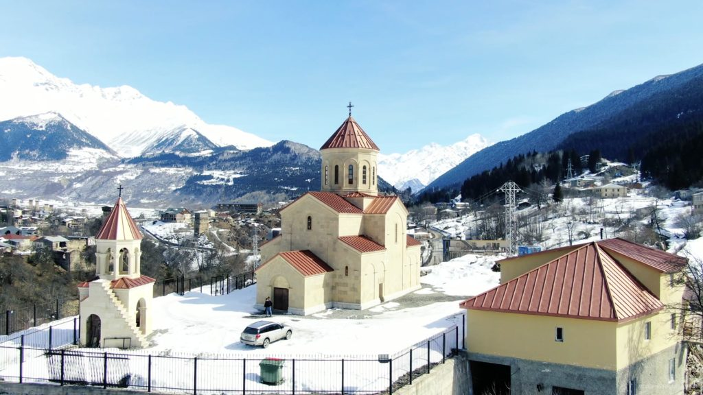 Beautiful-church-on-the-background-of-the-great-snow-capped-mountains-from-the-height-of-the-birds-eye_009 National Footage