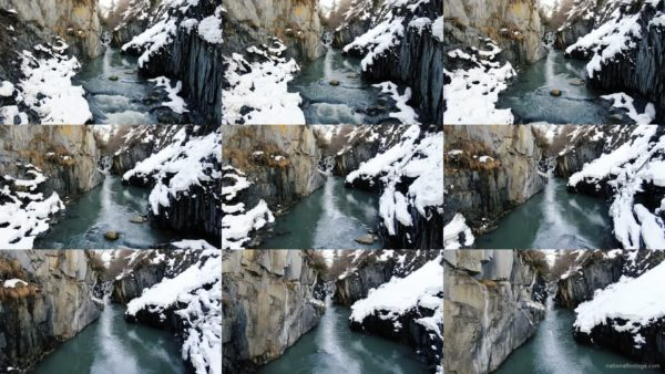 Beautiful-river-in-snowy-mountains-with-birds-eye-landscape-decoration National Footage