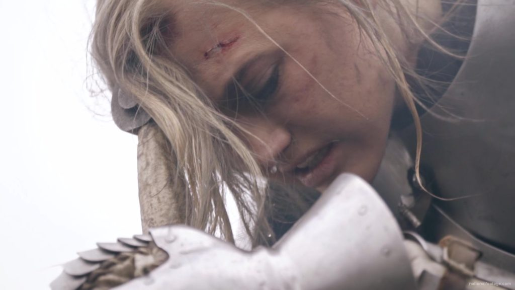 Beauty-Girl-Knight-female-warrior-face-sadly-cry-near-fire-with-sword_001 National Footage