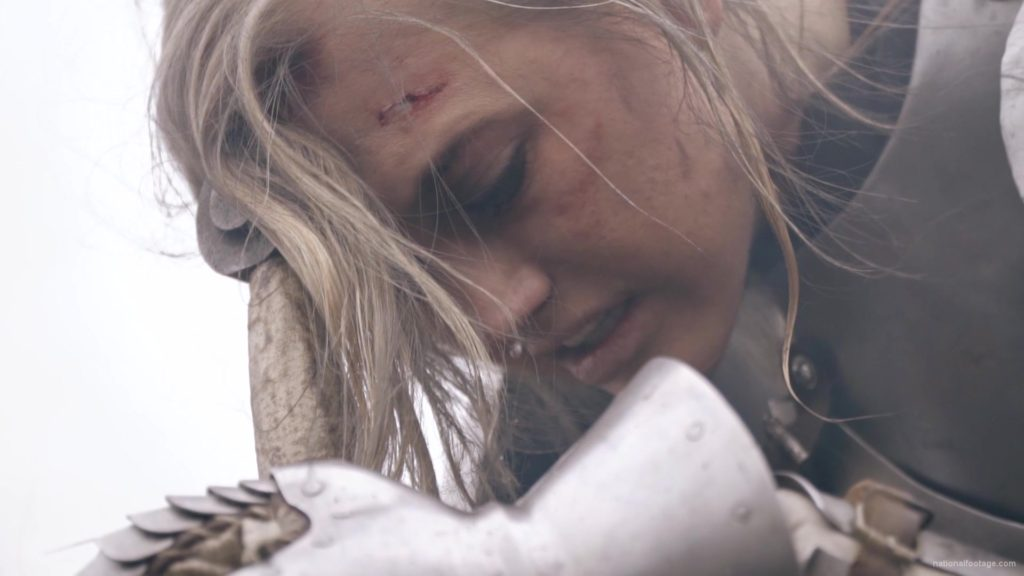 Beauty-Girl-Knight-female-warrior-face-sadly-cry-near-fire-with-sword_002 National Footage