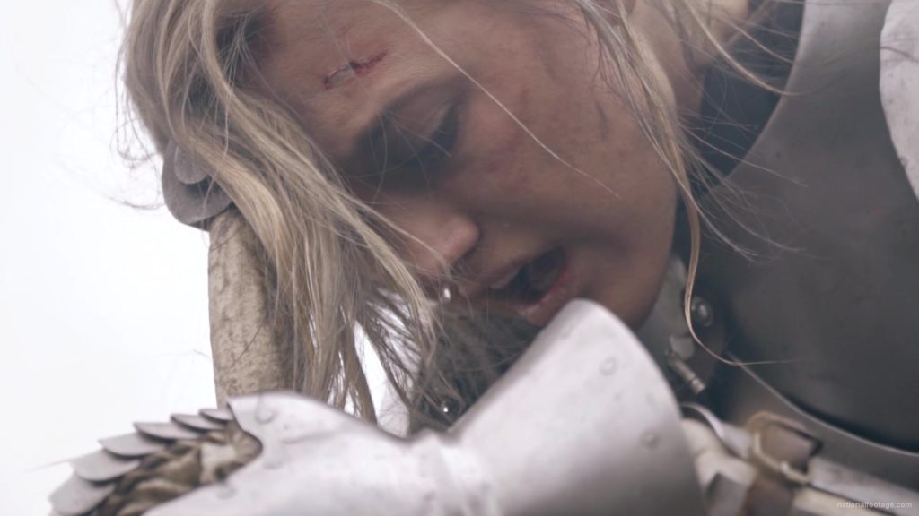 Beauty-Girl-Knight-female-warrior-face-sadly-cry-near-fire-with-sword_005 National Footage