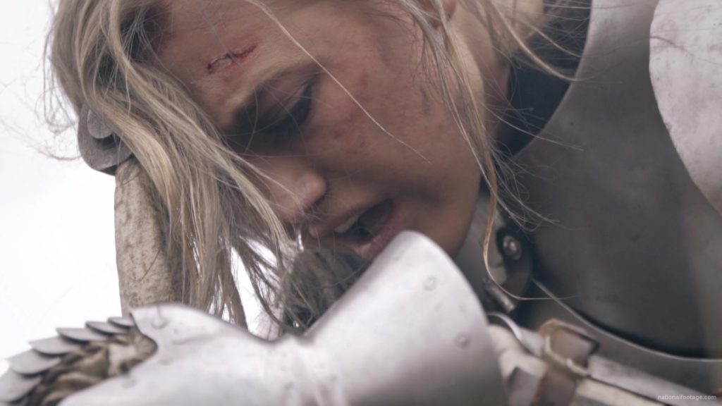 Beauty-Girl-Knight-female-warrior-face-sadly-cry-near-fire-with-sword_009 National Footage