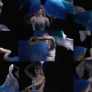 Belly-Dancing-woman-with-colorful-bows-waving-dancing-with-her National Footage