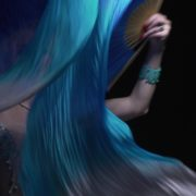 Belly-Dancing-woman-with-colorful-bows-waving-dancing-with-her_001 National Footage