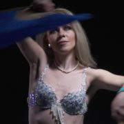 Belly-Dancing-woman-with-colorful-bows-waving-dancing-with-her_004 National Footage