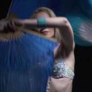 Belly-Dancing-woman-with-colorful-bows-waving-dancing-with-her_005 National Footage