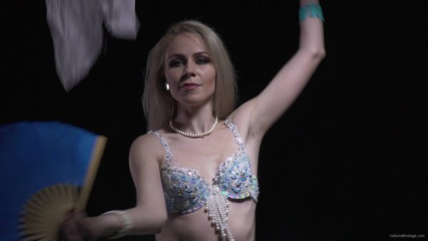 Belly-Dancing-woman-with-colorful-bows-waving-dancing-with-her_006 National Footage