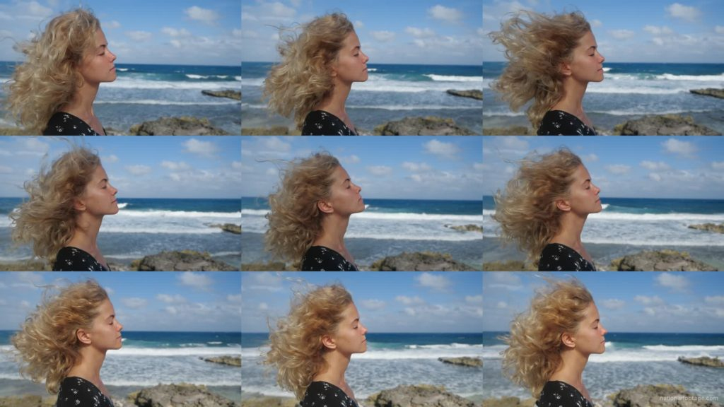 Blonde-girl-enjoy-the-wing-on-the-sea-ocean-in-slow-motion National Footage