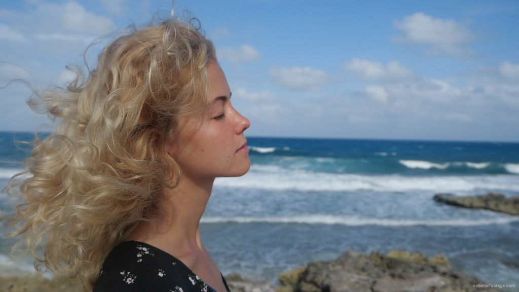 Blonde-girl-enjoy-the-wing-on-the-sea-ocean-in-slow-motion_001 National Footage