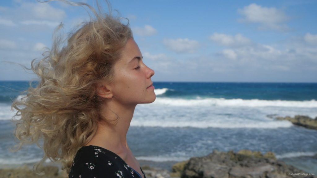 Blonde-girl-enjoy-the-wing-on-the-sea-ocean-in-slow-motion_004 National Footage