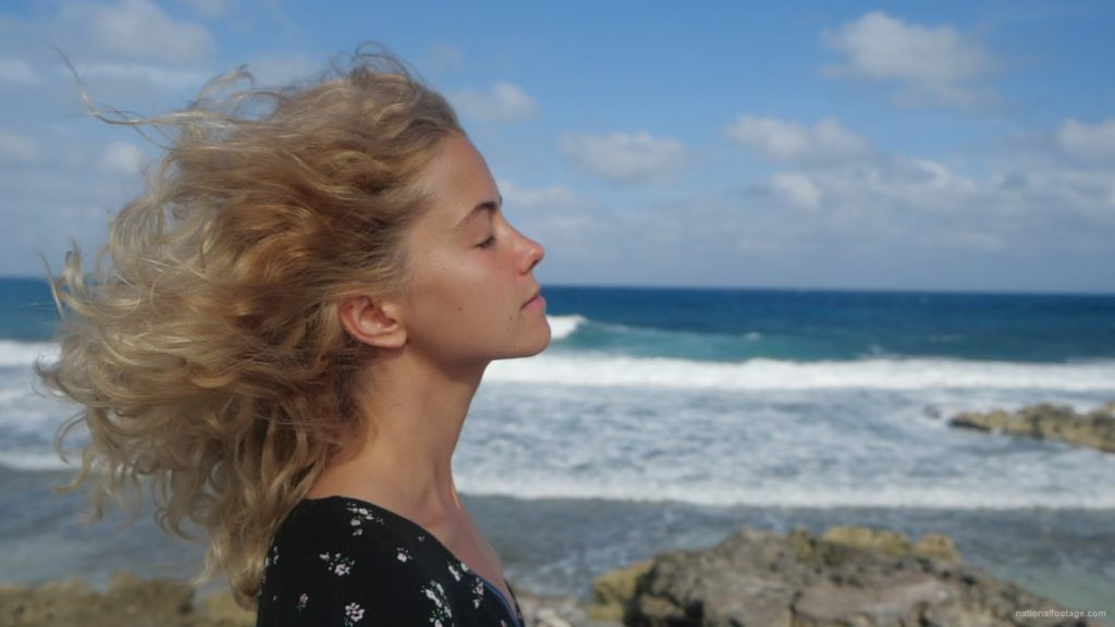 Blonde-girl-enjoy-the-wing-on-the-sea-ocean-in-slow-motion_006 National Footage