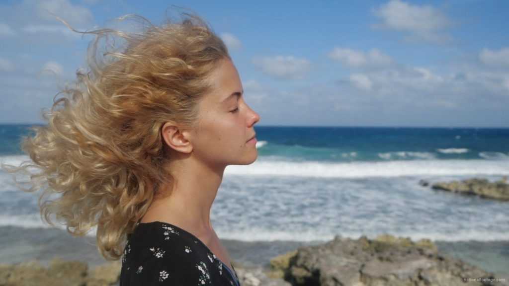 Blonde-girl-enjoy-the-wing-on-the-sea-ocean-in-slow-motion_007 National Footage