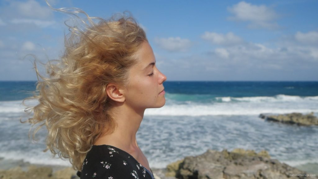 Blonde-girl-enjoy-the-wing-on-the-sea-ocean-in-slow-motion_008 National Footage