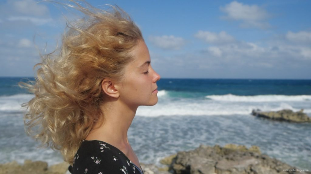 Blonde-girl-enjoy-the-wing-on-the-sea-ocean-in-slow-motion_009 National Footage