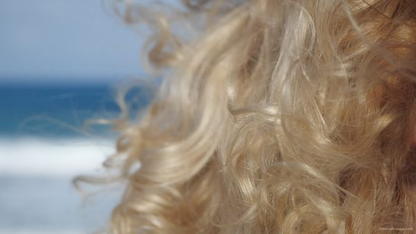 Bright-blonde-hair-play-with-wind-in-slow-motion-on-sea-background_001 National Footage