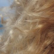 Bright-blonde-hair-play-with-wind-in-slow-motion-on-sea-background_002 National Footage