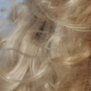 Bright-blonde-hair-play-with-wind-in-slow-motion-on-sea-background_006 National Footage