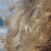 Bright-blonde-hair-play-with-wind-in-slow-motion-on-sea-background_007 National Footage