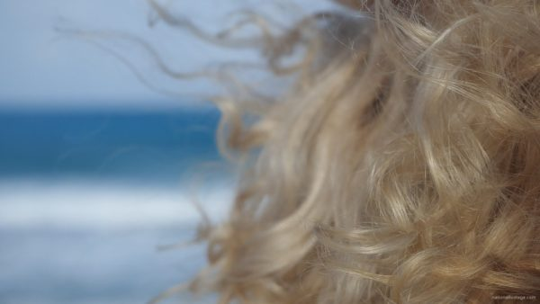 Bright-blonde-hair-play-with-wind-in-slow-motion-on-sea-background_009 National Footage
