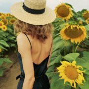 vj video background Elegant-Girl-is-walking-in-fields-of-Sun-Flowers-in-Summer-Day-4K_003