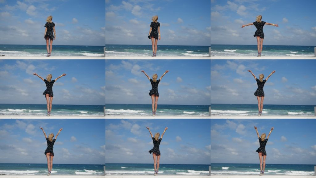 Girl-travel-raises-her-arms-and-hands-up-in-slow-motion-on-the-sea-ocean-beach National Footage